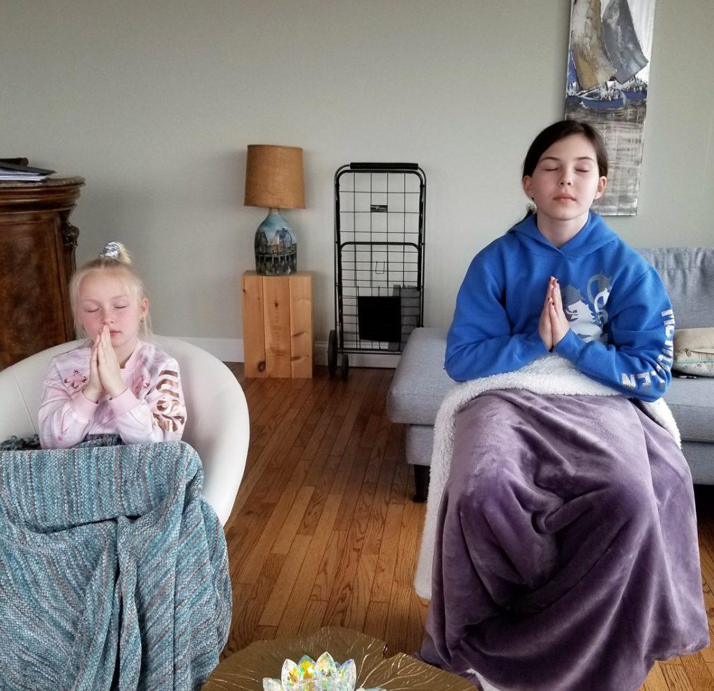 Two children receiving their attunement