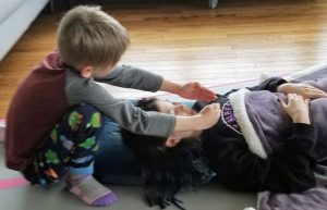 Children giving and receiving reiki.
